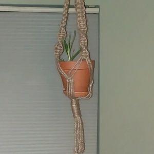 Handmade hemp macrame plant hanger.